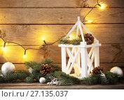 Купить «Christmas decorations on dark old wooden background», фото № 27135037, снято 18 октября 2017 г. (c) Майя Крученкова / Фотобанк Лори