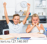 Купить «Boy is winners in game which he played with his sister», фото № 27140997, снято 7 августа 2017 г. (c) Яков Филимонов / Фотобанк Лори