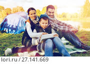 Купить «happy family with tablet pc and tent at camp site», фото № 27141669, снято 27 сентября 2015 г. (c) Syda Productions / Фотобанк Лори