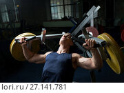 Купить «man doing chest press on exercise machine in gym», фото № 27141781, снято 2 июля 2017 г. (c) Syda Productions / Фотобанк Лори