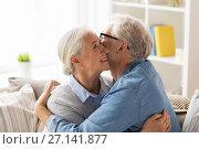 happy senior couple hugging at home. Стоковое фото, фотограф Syda Productions / Фотобанк Лори