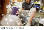 Купить «woman paying money at store cash register», фото № 27141893, снято 21 октября 2016 г. (c) Syda Productions / Фотобанк Лори