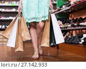 Купить «Adult customer is walking around the boutique», фото № 27142933, снято 10 мая 2017 г. (c) Яков Филимонов / Фотобанк Лори