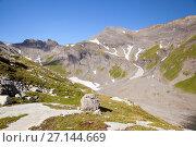 Купить «A mountains at Vieux Emosson lake in Alps on France–Switzerland border», фото № 27144669, снято 5 июля 2017 г. (c) Юлия Кузнецова / Фотобанк Лори