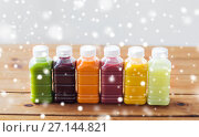 Купить «bottles with different fruit or vegetable juices», фото № 27144821, снято 5 августа 2016 г. (c) Syda Productions / Фотобанк Лори