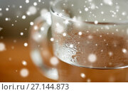 Купить «close up of glass with hot water», фото № 27144873, снято 13 октября 2016 г. (c) Syda Productions / Фотобанк Лори