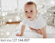 Купить «little baby in diaper crawling along sofa at home», фото № 27144897, снято 12 июля 2016 г. (c) Syda Productions / Фотобанк Лори