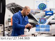 Купить «mechanic man with wrench repairing car at workshop», фото № 27144969, снято 1 июля 2016 г. (c) Syda Productions / Фотобанк Лори