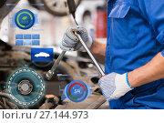 Купить «mechanic man with wrench repairing car at workshop», фото № 27144973, снято 1 июля 2016 г. (c) Syda Productions / Фотобанк Лори