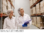 Купить «women technologists at ice cream factory warehouse», фото № 27145061, снято 17 июля 2017 г. (c) Syda Productions / Фотобанк Лори