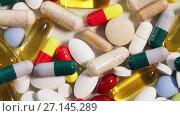 Купить «close up different pills», видеоролик № 27145289, снято 6 октября 2017 г. (c) Syda Productions / Фотобанк Лори