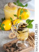 Купить «A cup of freshly lemon tea with fresh mint.», фото № 27145389, снято 20 октября 2017 г. (c) Olesya Tseytlin / Фотобанк Лори