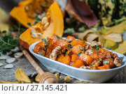 Купить «Baked pumpkin with nuts and thyme leaves under honey glaze.», фото № 27145421, снято 12 октября 2017 г. (c) Olesya Tseytlin / Фотобанк Лори