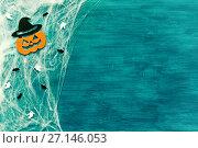 Купить «Halloween background. Spider web, spiders and smiling jack decorations as symbols of Halloween», фото № 27146053, снято 18 октября 2017 г. (c) Зезелина Марина / Фотобанк Лори