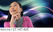 Купить «Woman looking up casually with colorful curves background», фото № 27147425, снято 19 апреля 2019 г. (c) Wavebreak Media / Фотобанк Лори