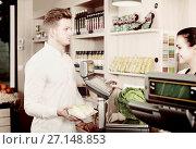 Купить «Young woman assistant helping customer», фото № 27148853, снято 23 ноября 2016 г. (c) Яков Филимонов / Фотобанк Лори