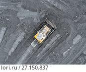 Купить «Open pit mine, breed sorting. Mining coal. Bulldozer sorts coal. Extractive industry, anthracite. Coal industry.», фото № 27150837, снято 26 сентября 2017 г. (c) Сергей Тимофеев / Фотобанк Лори