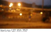 Купить «Blurred view of city highway in dusk with trace of red automobile headlight beams», видеоролик № 27151757, снято 11 августа 2017 г. (c) Яков Филимонов / Фотобанк Лори