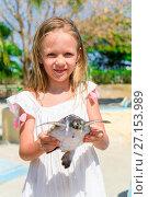 Купить «Adorable little girl with a small turtle in her hands in the natural reserve», фото № 27153989, снято 10 апреля 2017 г. (c) Дмитрий Травников / Фотобанк Лори