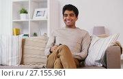 Купить «man with remote control watching tv at home», видеоролик № 27155961, снято 5 апреля 2020 г. (c) Syda Productions / Фотобанк Лори