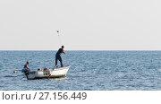 Купить «Two fishermen catching fish, Montenegro», фото № 27156449, снято 1 октября 2017 г. (c) Ekaterina Andreeva / Фотобанк Лори