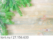 Купить «Winter background. Green fir tree branches with winter snowflakes on the wooden background», фото № 27156633, снято 8 мая 2017 г. (c) Зезелина Марина / Фотобанк Лори