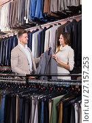 Купить «friendly female seller demonstrating men's shirts to customer», фото № 27157253, снято 16 июля 2018 г. (c) Яков Филимонов / Фотобанк Лори