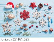 Купить «Christmas collection on wooden background», фото № 27161525, снято 28 октября 2017 г. (c) Майя Крученкова / Фотобанк Лори