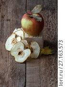 Купить «Apple and apple chips on an old wooden table.», фото № 27163573, снято 30 октября 2017 г. (c) Olesya Tseytlin / Фотобанк Лори