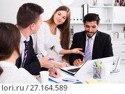 Купить «Business colleagues at joint meeting», фото № 27164589, снято 20 марта 2019 г. (c) Яков Филимонов / Фотобанк Лори
