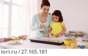 Купить «happy mother and daughter making cookies at home», видеоролик № 27165181, снято 20 августа 2019 г. (c) Syda Productions / Фотобанк Лори