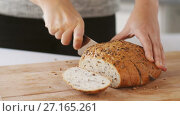 Купить «close up of hands cutting white bread with knife», видеоролик № 27165261, снято 22 мая 2019 г. (c) Syda Productions / Фотобанк Лори