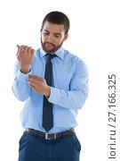 Купить «Businessman putting the cuff buttons», фото № 27166325, снято 8 августа 2017 г. (c) Wavebreak Media / Фотобанк Лори