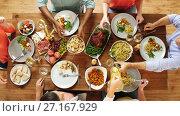 Купить «group of people eating at table with food», видеоролик № 27167929, снято 23 апреля 2019 г. (c) Syda Productions / Фотобанк Лори