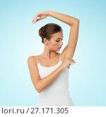 Купить «woman with antiperspirant deodorant over white», фото № 27171305, снято 9 апреля 2017 г. (c) Syda Productions / Фотобанк Лори