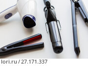 Купить «hairdryer, hot styling and curling irons», фото № 27171337, снято 12 апреля 2017 г. (c) Syda Productions / Фотобанк Лори