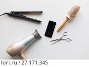 Купить «smartphone, scissors, hairdryer, iron and brush», фото № 27171345, снято 12 апреля 2017 г. (c) Syda Productions / Фотобанк Лори