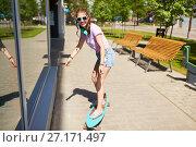 Купить «happy teenage girl in shades riding on longboard», фото № 27171497, снято 17 июня 2017 г. (c) Syda Productions / Фотобанк Лори
