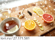 Купить «ginger tea with honey, citrus and garlic on wood», фото № 27171581, снято 13 октября 2016 г. (c) Syda Productions / Фотобанк Лори
