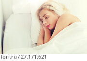 Купить «young woman sleeping in bed at home bedroom», фото № 27171621, снято 25 февраля 2016 г. (c) Syda Productions / Фотобанк Лори