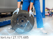 Купить «mechanic with wheel tire at car workshop», фото № 27171685, снято 1 июля 2016 г. (c) Syda Productions / Фотобанк Лори