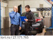 Купить «auto mechanic and customer at car shop», фото № 27171765, снято 21 сентября 2017 г. (c) Syda Productions / Фотобанк Лори