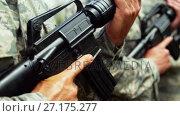 Купить «Group of military soldiers standing with rifles 4k», видеоролик № 27175277, снято 22 мая 2019 г. (c) Wavebreak Media / Фотобанк Лори