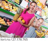 Купить «Woman with daughter looking satisfied in fruit store», фото № 27178765, снято 25 июня 2019 г. (c) Яков Филимонов / Фотобанк Лори