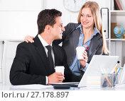 Купить «Adult business couple flirting in office», фото № 27178897, снято 20 апреля 2017 г. (c) Яков Филимонов / Фотобанк Лори