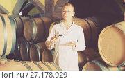 Купить «Woman checking ageing process of wine», фото № 27178929, снято 21 сентября 2016 г. (c) Яков Филимонов / Фотобанк Лори