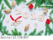 Купить «New Year 2018 background with 2018 figures, Christmas toys, fir branches. New Year 2018 still life», фото № 27178957, снято 30 ноября 2016 г. (c) Зезелина Марина / Фотобанк Лори
