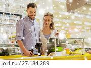 Купить «couple buying food at grocery store cash register», фото № 27184289, снято 21 октября 2016 г. (c) Syda Productions / Фотобанк Лори