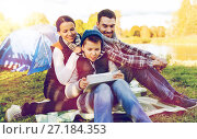Купить «happy family with tablet pc and tent at camp site», фото № 27184353, снято 27 сентября 2015 г. (c) Syda Productions / Фотобанк Лори