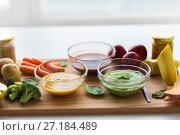 Купить «vegetable puree or baby food in glass bowls», фото № 27184489, снято 21 февраля 2017 г. (c) Syda Productions / Фотобанк Лори